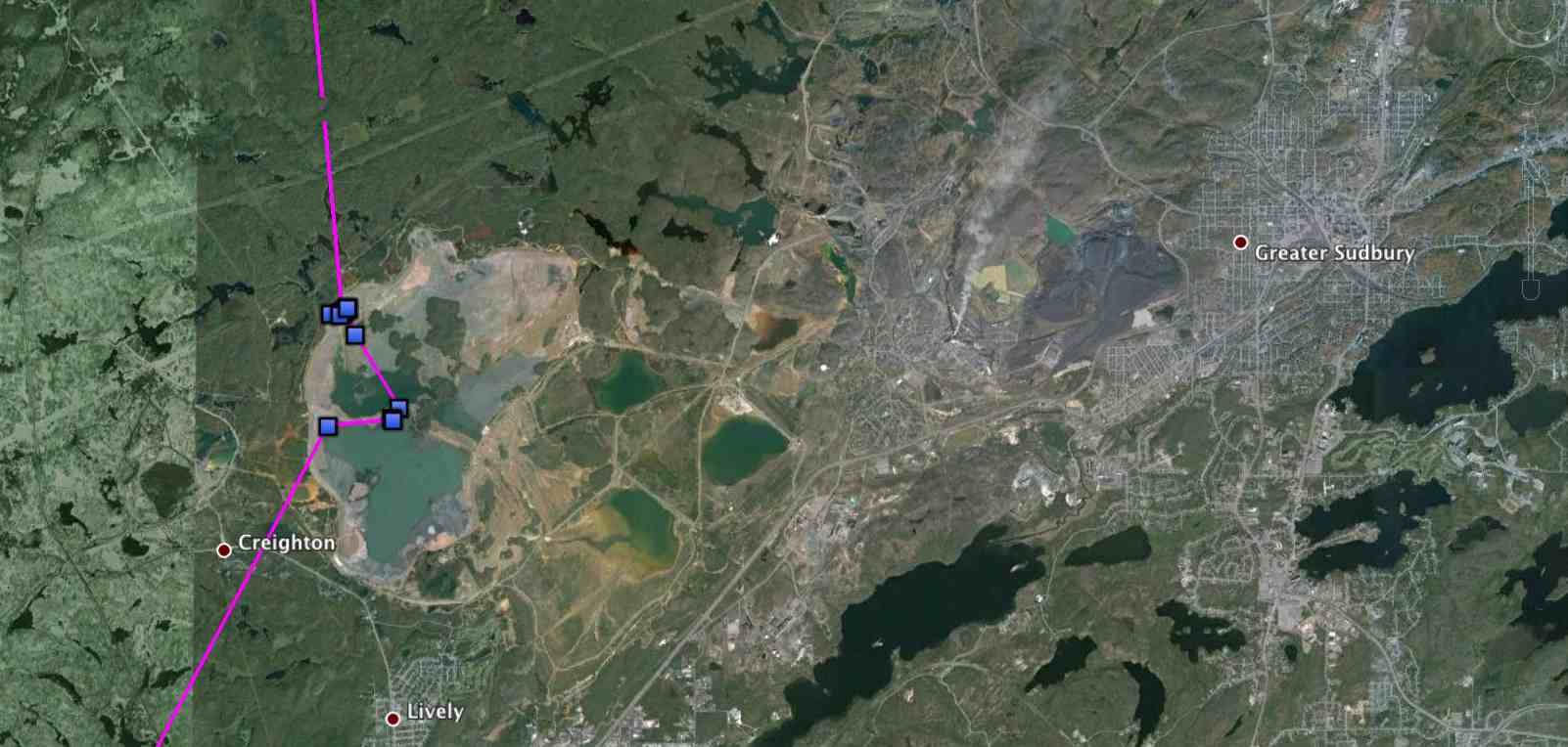 Millcreek's quick visit to the mine tailings ponds in Sudbury, ON -- probably just as well he didn't linger. (The exhaust plume from the town's infamous Inco Superstack, the tallest chimney in the western hemisphere at the world's largest nickel smelter, is visible near the middle of the image.) (©Project SNOWstorm and Google Earth)