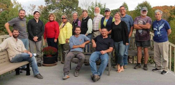 Some of the faces behind Project SNOWstorm. Seated, Bob Fogg, Jean-François Therrien and Mike Lanzone. From left, Drew Weber, Andrew McGann, Sherrill Davison, Cindy Driscoll, Erica Miller, Scott Weidensaul, Dave Brinker, Lauren Gilpatrick, Trish Miller, David LaPuma, Tom McDonald (trying to hide his barn owl shirt) and Norman Smith. (©Lauren Gilpatrick)
