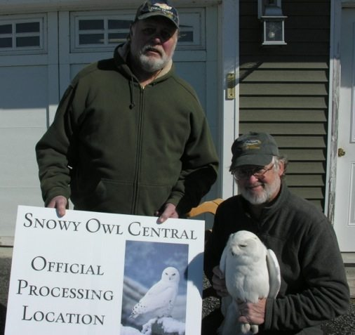 "Tom McDonald, right, and Bob Gallagher outside ""Snowy Owl central,"" Tom's nickname for the Gallagher House near Three Mile Bay, NY, where he traps so many snowy owls. (©Tom McDonald)"